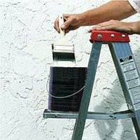 Painting on a ladder